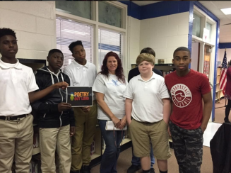Ms Cason shares moment with talented middle schoolers after observing competition. Note: TJ Taylor (far right) represented his classmates in stirring performance of Solider Or Body.